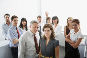 Businesspeople posing in office